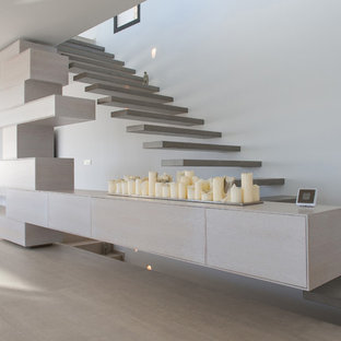 Trendy painted floating open staircase photo in Alicante-Costa Blanca