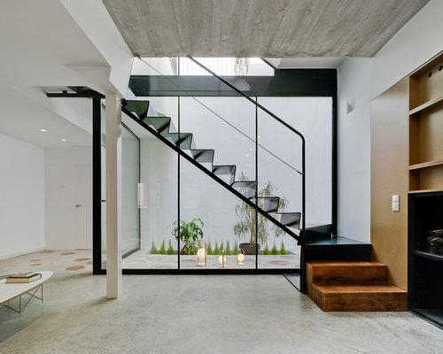 imagen de escalera en l moderna de tamao medio con escalones de metal - Escaleras Modernas