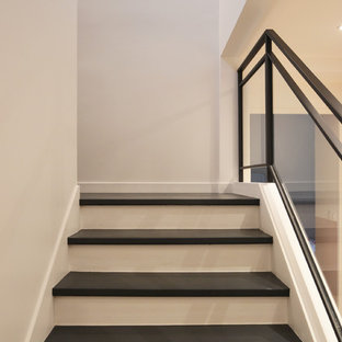 Inspiration for a contemporary painted metal railing staircase remodel in Paris with painted risers
