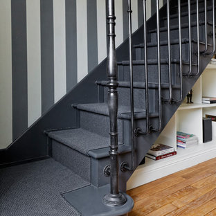 Example of a classic painted straight staircase design in Paris with painted risers