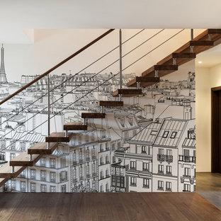 Idées déco pour un escalier sans contremarche droit contemporain de taille moyenne avec des marches en bois.
