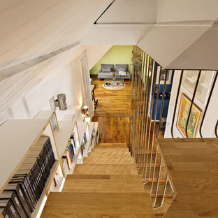 Mid-sized minimalist wooden floating metal railing staircase photo in Paris with glass risers