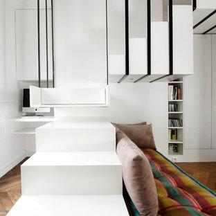 Cette photo montre un escalier tendance en L de taille moyenne avec des marches en bois.
