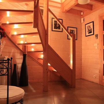 Maison bois madriers et ossature bois