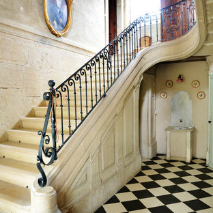 Large transitional concrete u-shaped staircase photo in Lyon with concrete risers