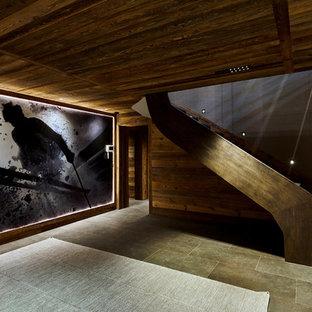 Idée de décoration pour un escalier sans contremarche droit chalet de taille moyenne avec des marches en bois.
