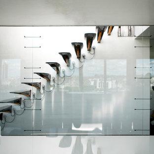 Réalisation d'un escalier sans contremarche flottant design de taille moyenne.