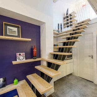 Idée de décoration pour un escalier sans contremarche droit design avec des marches en bois.