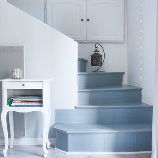 Inspiration for a mid-sized shabby-chic style tile curved staircase remodel in Montpellier with tile risers