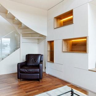 Foto de escalera en U, contemporánea, de tamaño medio, con escalones de acrílico y barandilla de varios materiales