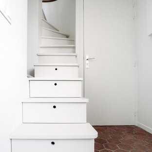 Small 1960s painted curved staircase photo in Paris with painted risers