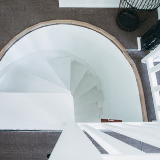Small 1950s painted curved staircase photo in Paris with painted risers