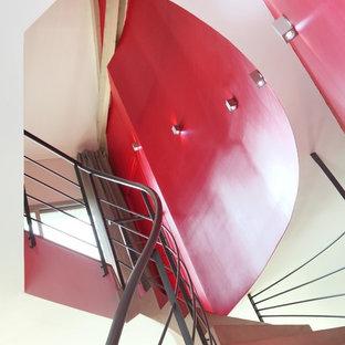 Ejemplo de escalera curva, contemporánea, de tamaño medio, con escalones de hormigón