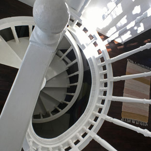 Staircase - mediterranean painted spiral staircase idea in Other with painted risers