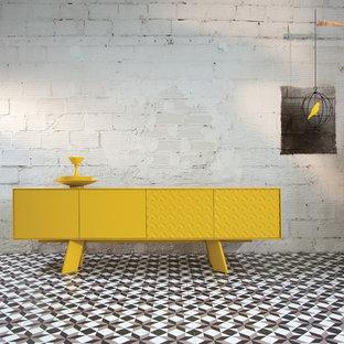 Foto de comedor contemporáneo, grande, abierto, sin chimenea, con suelo de baldosas de cerámica, paredes grises, marco de chimenea de hormigón y suelo multicolor