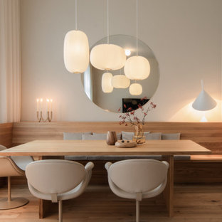 Small danish light wood floor and beige floor dining room photo in Frankfurt with white walls and no fireplace