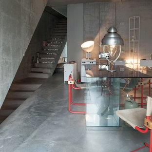 Foto de comedor industrial, de tamaño medio, con paredes grises y suelo de cemento