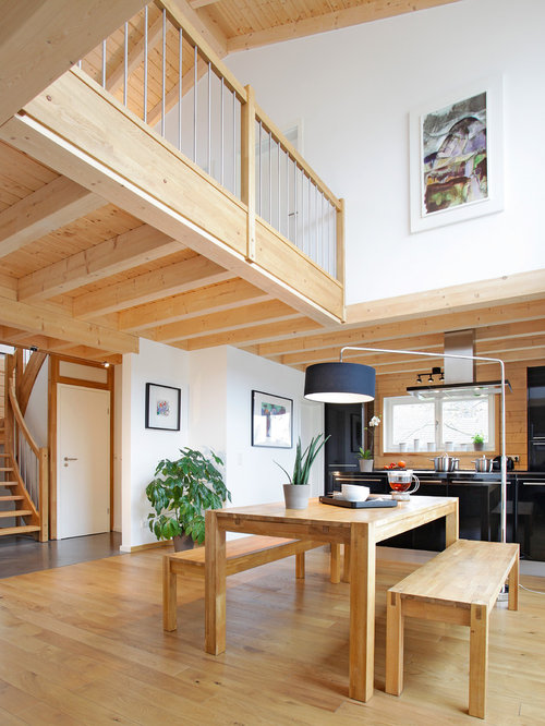 Example of a large trendy medium tone wood floor great room design in  Cologne with white