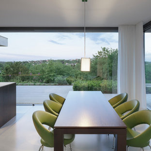 Example of a minimalist kitchen/dining room combo design in Cologne