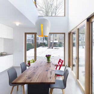 Mid-sized urban dining room photo in Leipzig with white walls and no fireplace