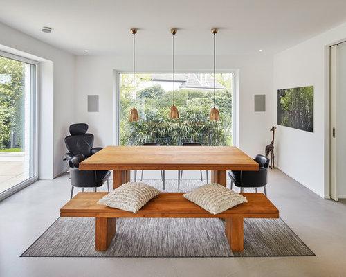 Inspiration Für Offene, Mittelgroße Moderne Esszimmer Mit Weißen Wänden Und  Betonboden In Düsseldorf