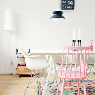 Inspiration for a scandinavian light wood floor dining room remodel in Dusseldorf with white walls