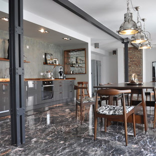 Dining room - mid-sized industrial marble floor dining room idea in Frankfurt with white walls
