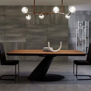 Inspiration för stora moderna matplatser med öppen planlösning, med betonggolv, grått golv, vita väggar, en hängande öppen spis och en spiselkrans i metall