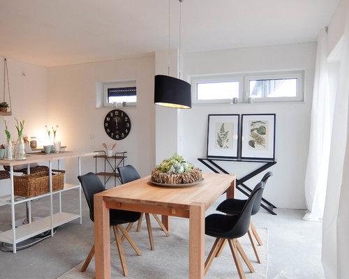 Offenes, Kleines Skandinavisches Esszimmer Mit Weißer Wandfarbe, Betonboden  Und Grauem Boden In Bremen