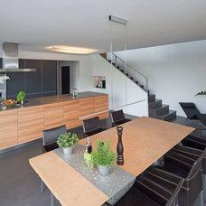 Contemporary Dining Room by Kärcher Architekten