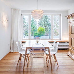 Inspiration for a mid-sized scandinavian light wood floor great room remodel in Munich with white walls and a wood stove