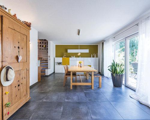 sala da pranzo aperta verso il soggiorno con pavimento in ardesia ... - Soggiorno Pareti Verdi 2