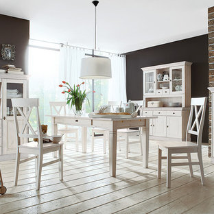 Inspiration for a scandinavian painted wood floor dining room remodel in Stuttgart with black walls