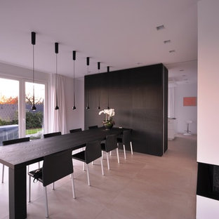 Inspiration for an expansive contemporary dining room in Dusseldorf with white walls and beige floor.