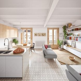 Modelo de comedor contemporáneo, abierto, con paredes blancas y suelo gris