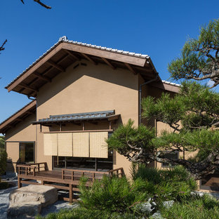 Inspiration for an asian brown two-story mixed siding gable roof remodel in Kyoto