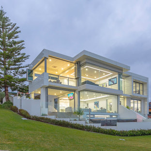 Contemporary two-storey glass white house exterior in Perth with a flat roof.