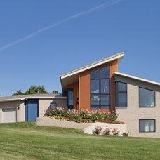 Contemporary Exterior by Bouril Design Studio, LLC