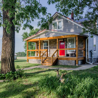 Small farmhouse gray two-story concrete fiberboard exterior home photo in St Louis with a metal roof