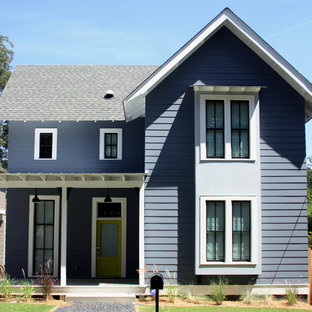Example of a mid-sized farmhouse blue two-story wood gable roof design in Atlanta