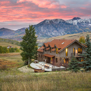 Inspiration for a large rustic two-story mixed siding gable roof remodel in Denver