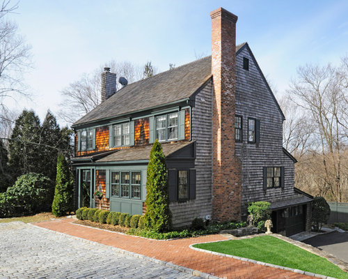 Example Of A Classic Brown Two Story Wood Gable Roof Design In New York With