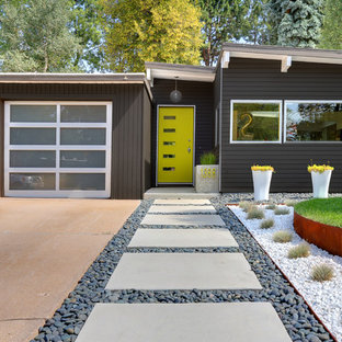 Midcentury modern gray one-story exterior home photo in Denver