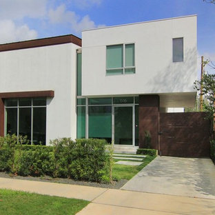 Example of a trendy white metal exterior home design in Houston