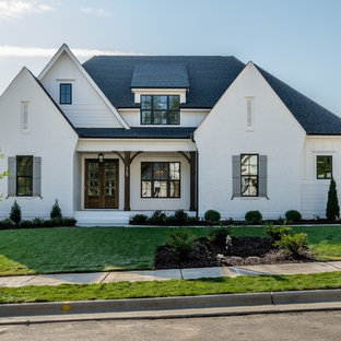 Inspiration for a large farmhouse white two-story mixed siding house exterior remodel in Raleigh with a shingle roof and a hip roof