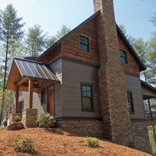 Rustic Exterior by Higgins Building Group, Inc.