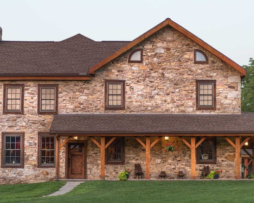 country brown two story stone gable roof photo in other with a shingle roof - Stone Slab Canopy Decoration