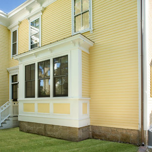 Traditional yellow two-story wood exterior home idea in Boston