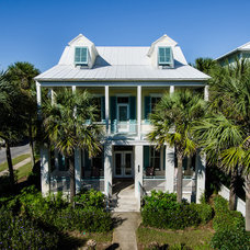 Tropical Exterior by Emerald Coast Real Estate Photography