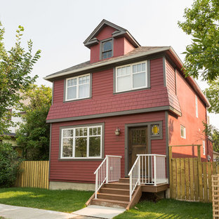 Example of a mid-sized farmhouse red two-story mixed siding house exterior design in Calgary with a hip roof and a shingle roof